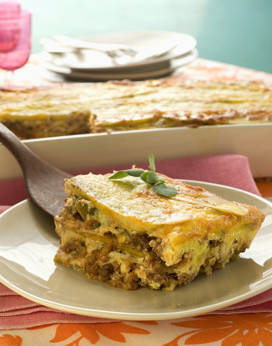 Piece of Plantain Lasagna on a Plate; Spatula
