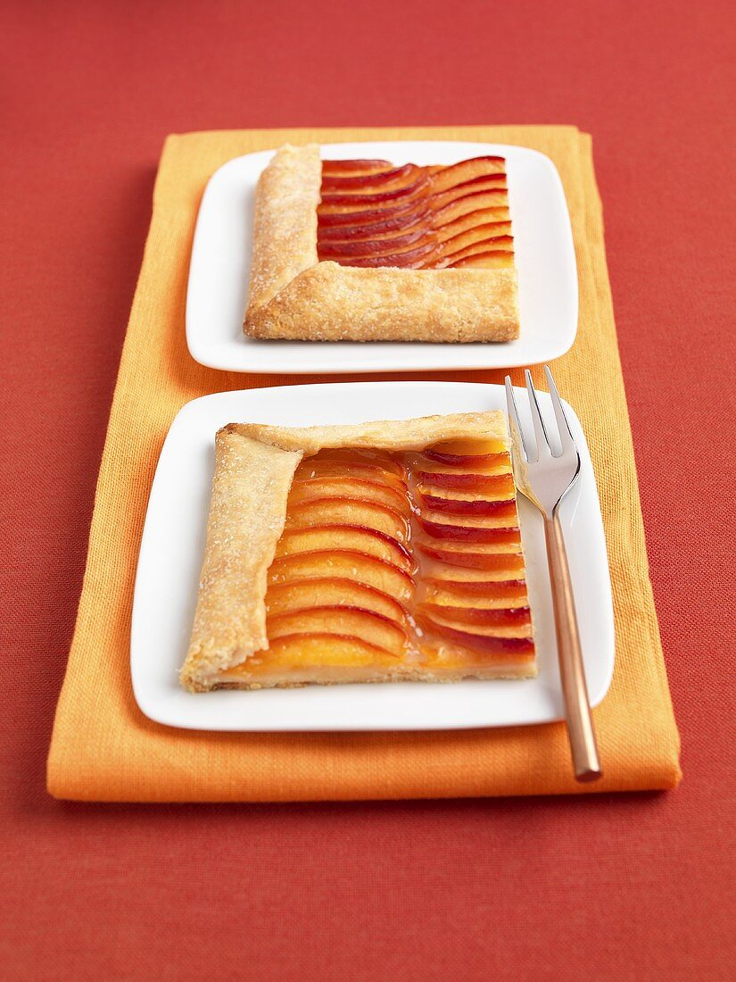 Two Slices of Nectarine Galette on Plates