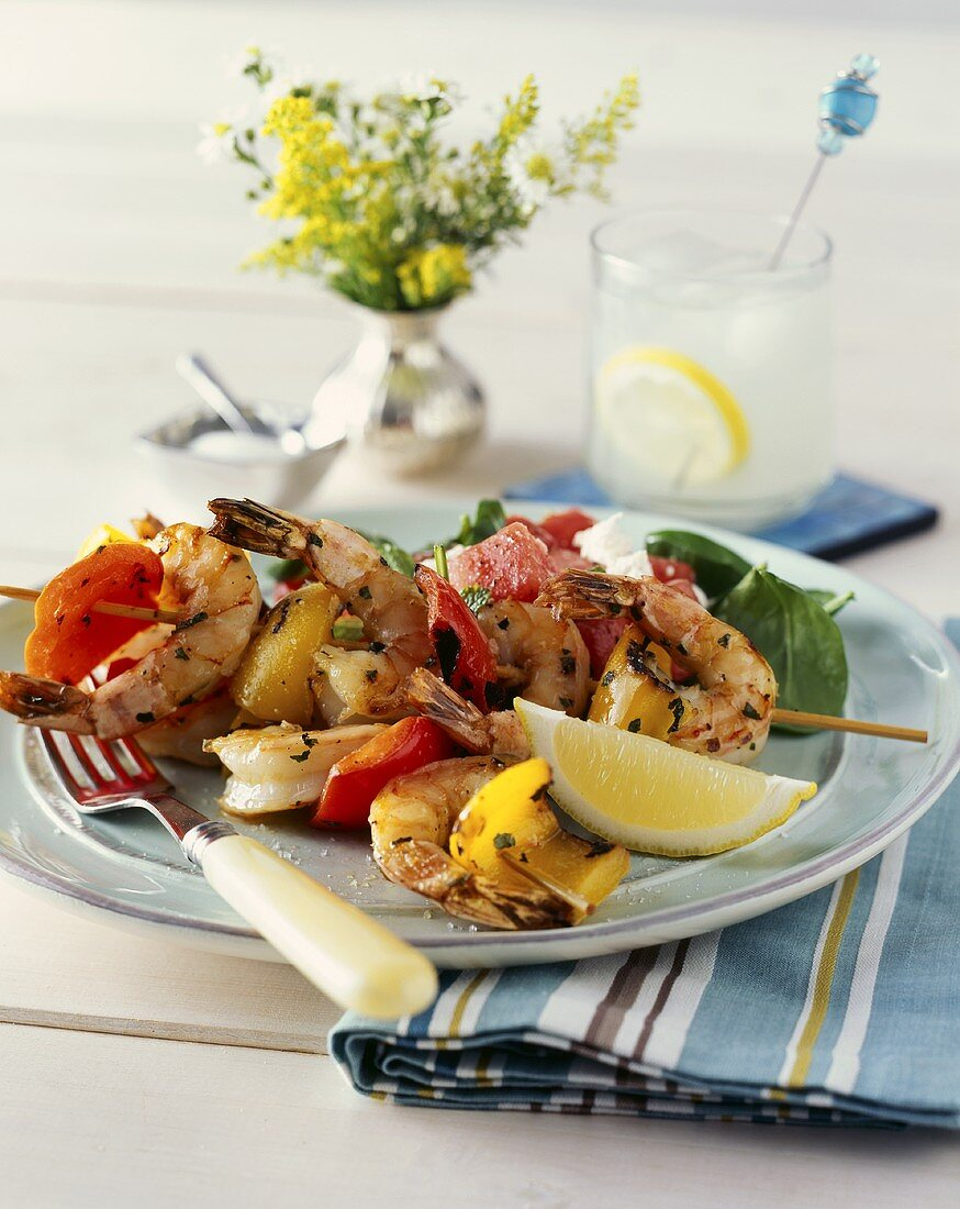 Grilled prawn kebab with red and yellow peppers