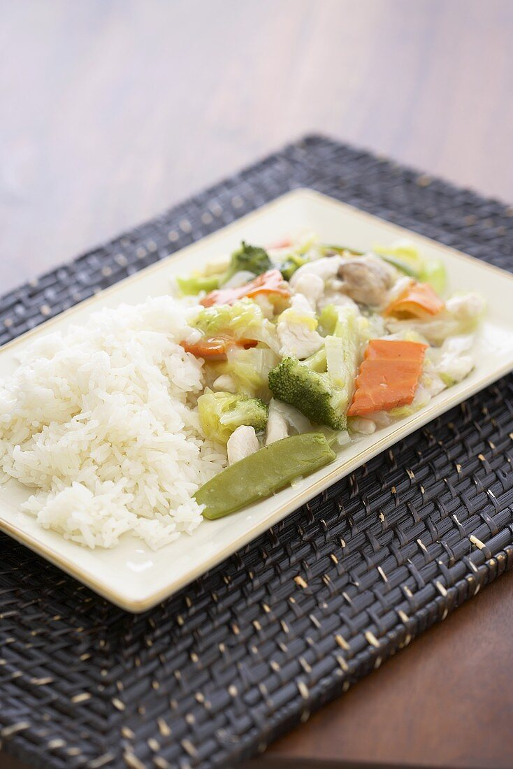 Chicken & vegetable chop suey with rice on serving platter
