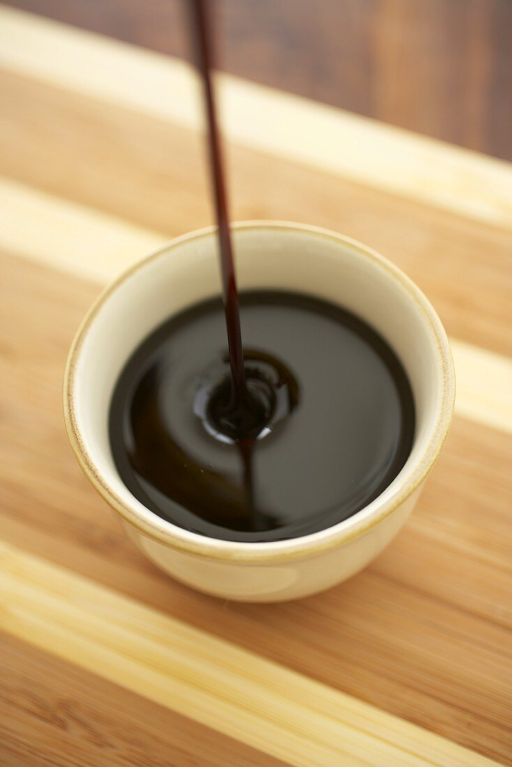 Pouring Sorghum Syrup into a Cup