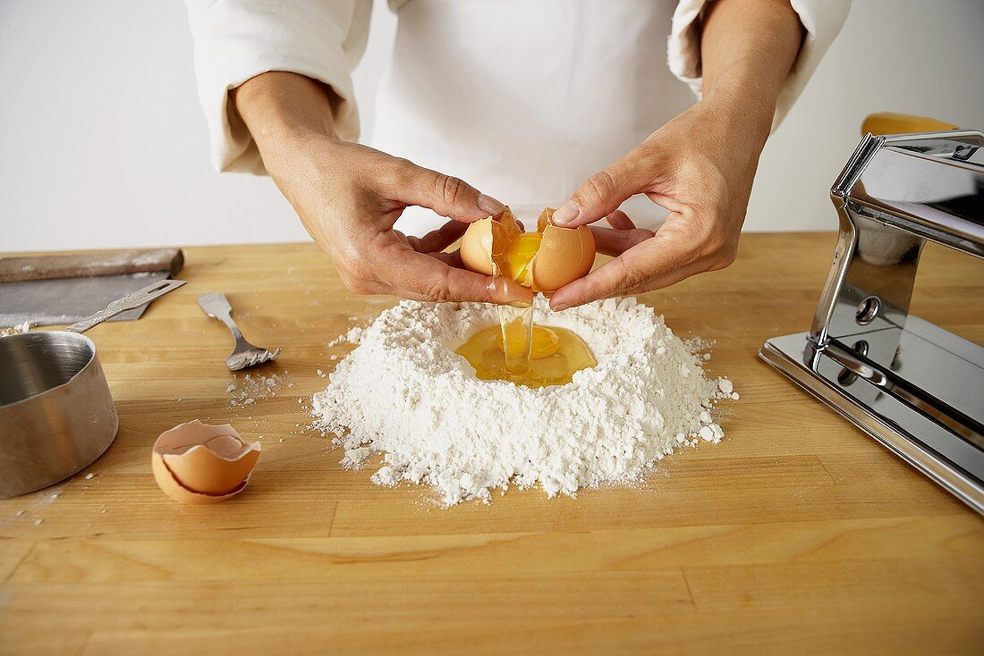 Making Pasta: Cracking Eggs into Flour