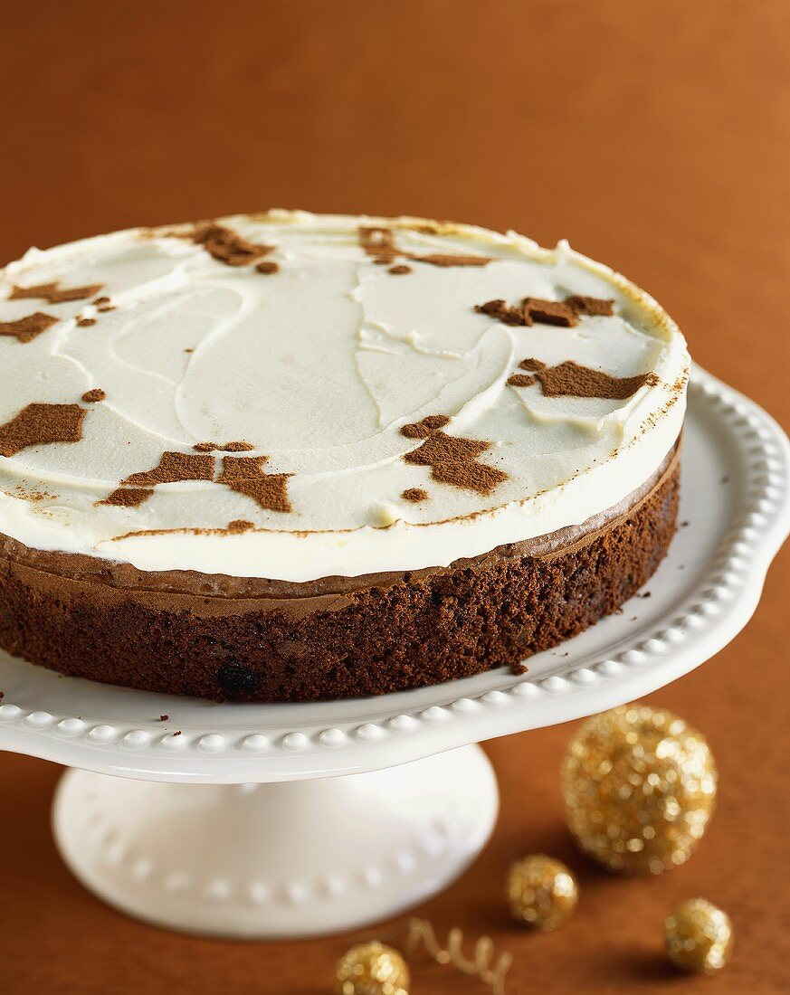 Chocolate Christmas Torte with Cocoa Powder Holly Decoration