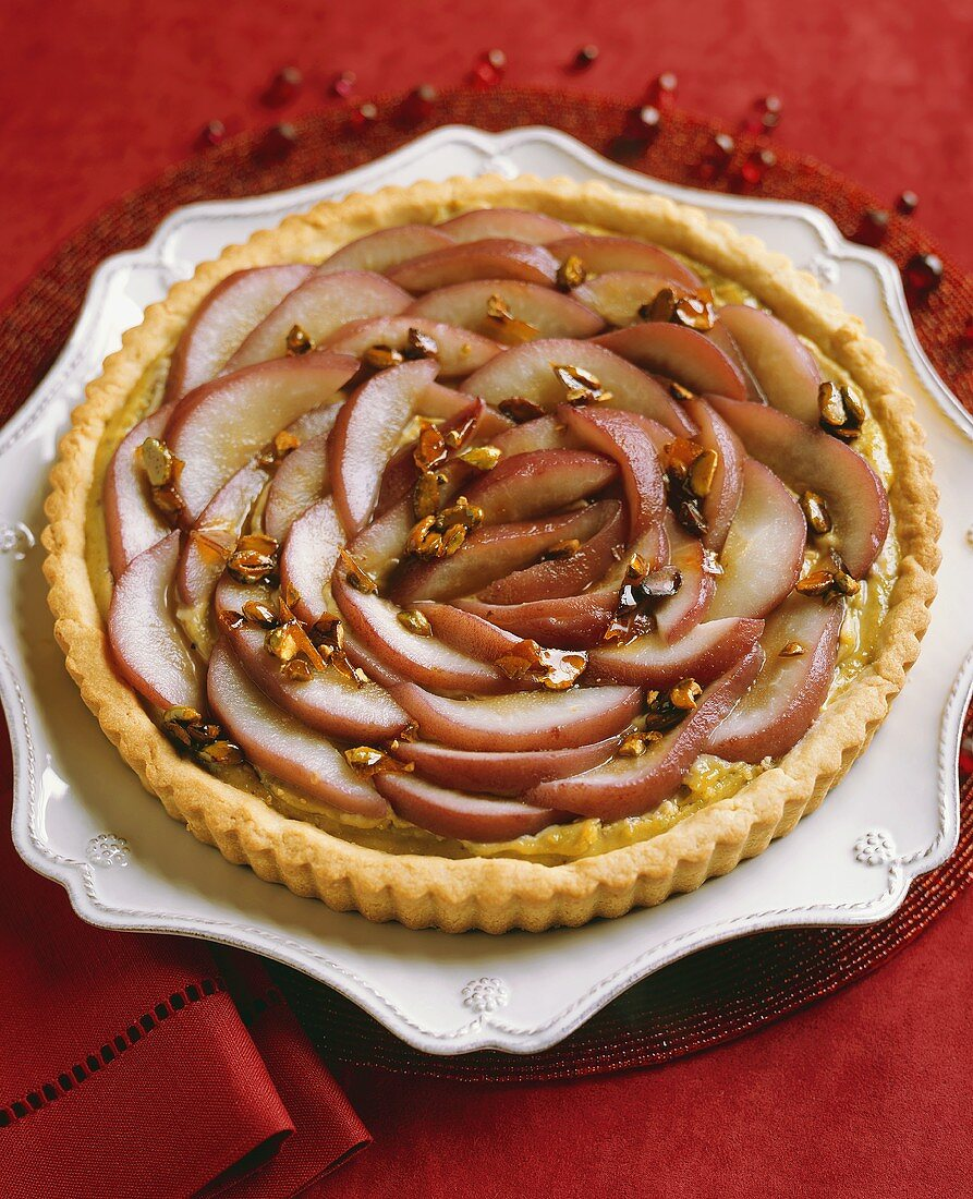 Poached pear tart with caramelised pistachios, from above