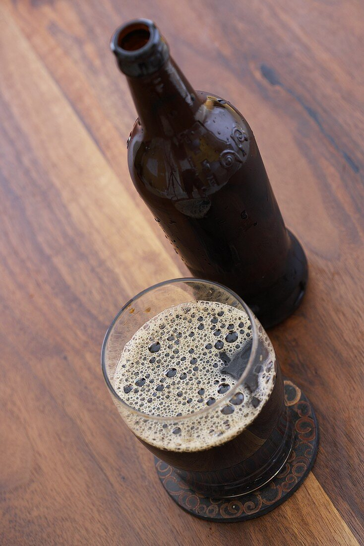 Imported Chocolate Malt Wheat Beer in a Glass with Bottle