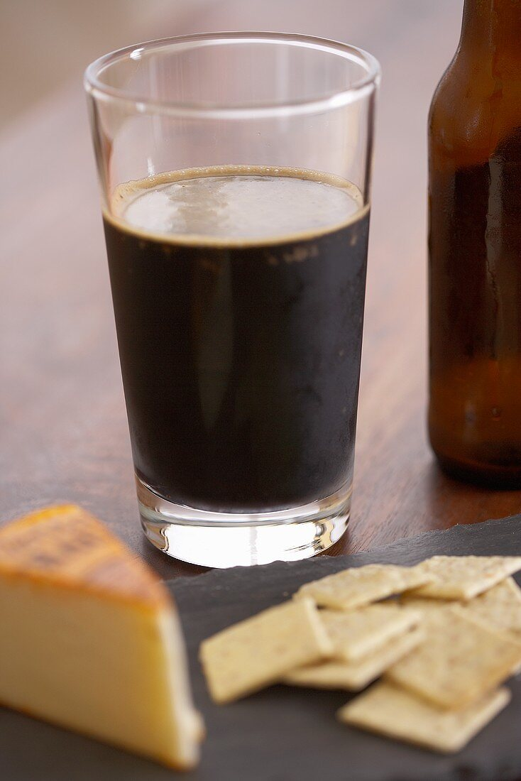 Glass of Dark Beer with Muenster Cheese and Crackers