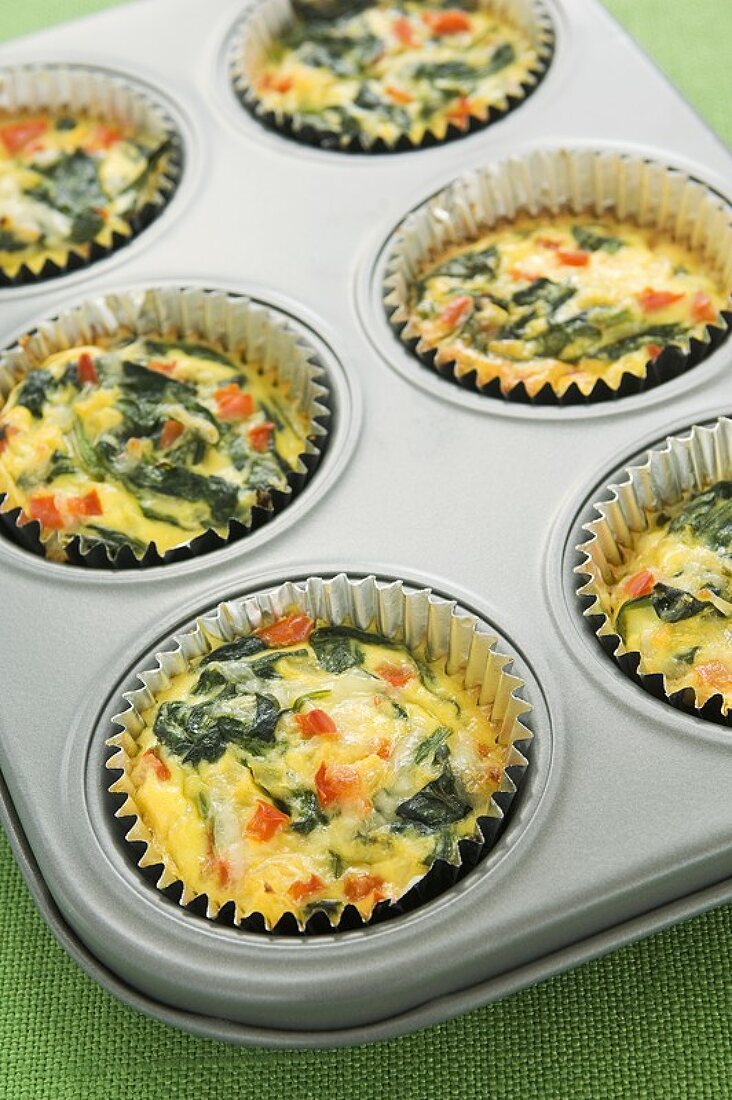 Mini Spinach Quiches in Muffin Cups in Muffin Pan