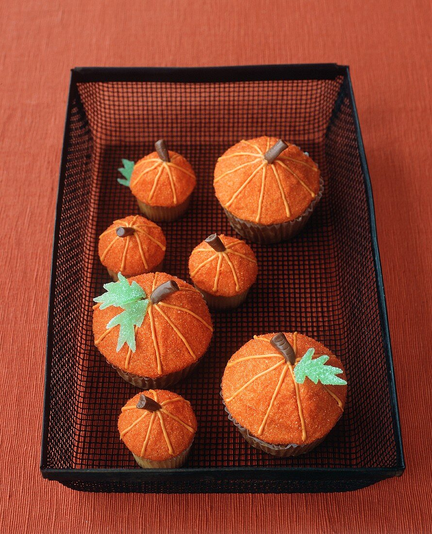 Decorated Pumpkin Cupcakes in a Wire Basket