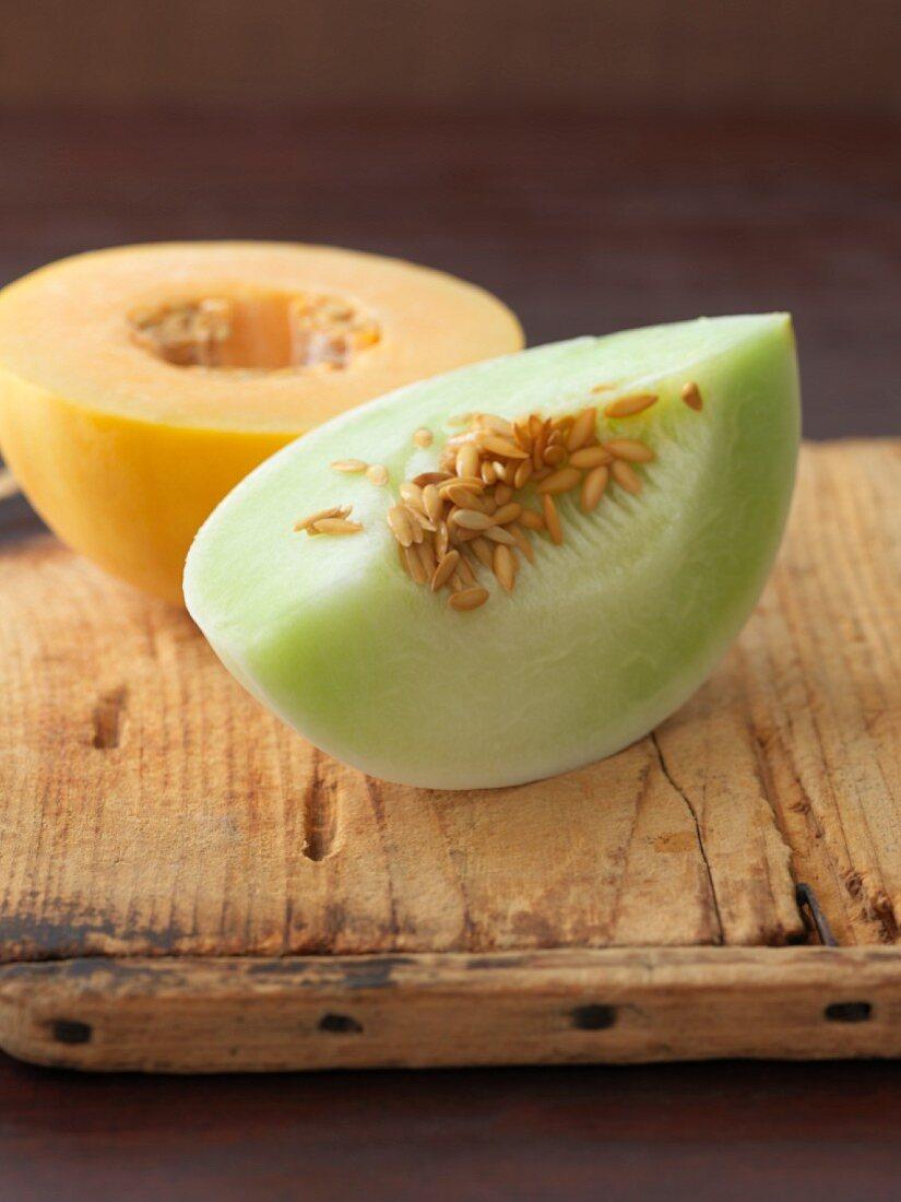 Honeydew melon: half a melon and a wedge of melon