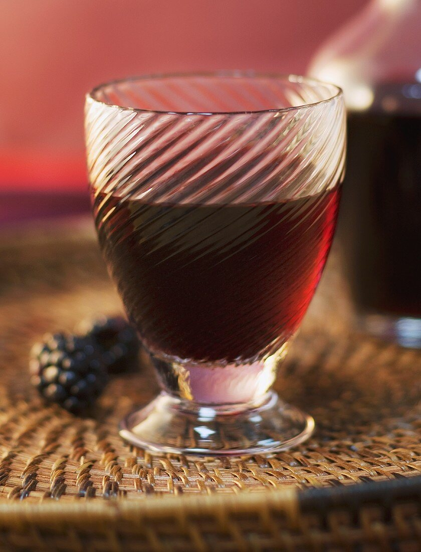 Glass of Red Wine on a Basket Tray