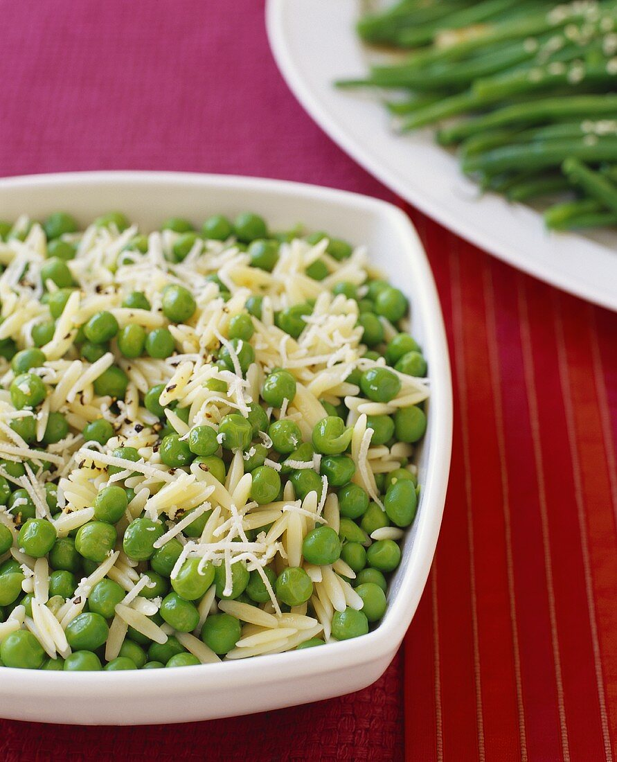 Orzo and Peas with Shredded Cheese in Serving Bowl