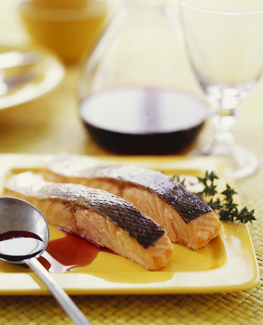 Two Salmon Fillets with Skin; Spoon with Sauce