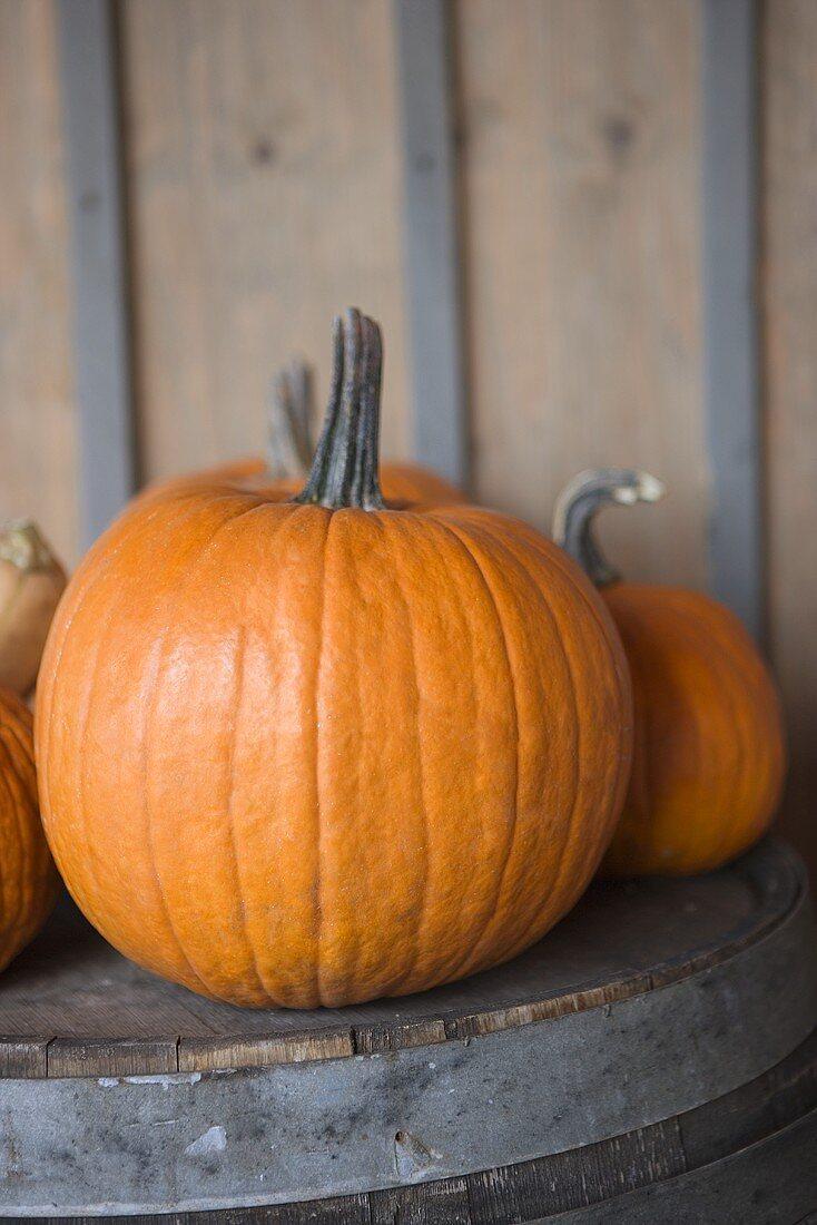 Pumpkins on a Wooden Barrel