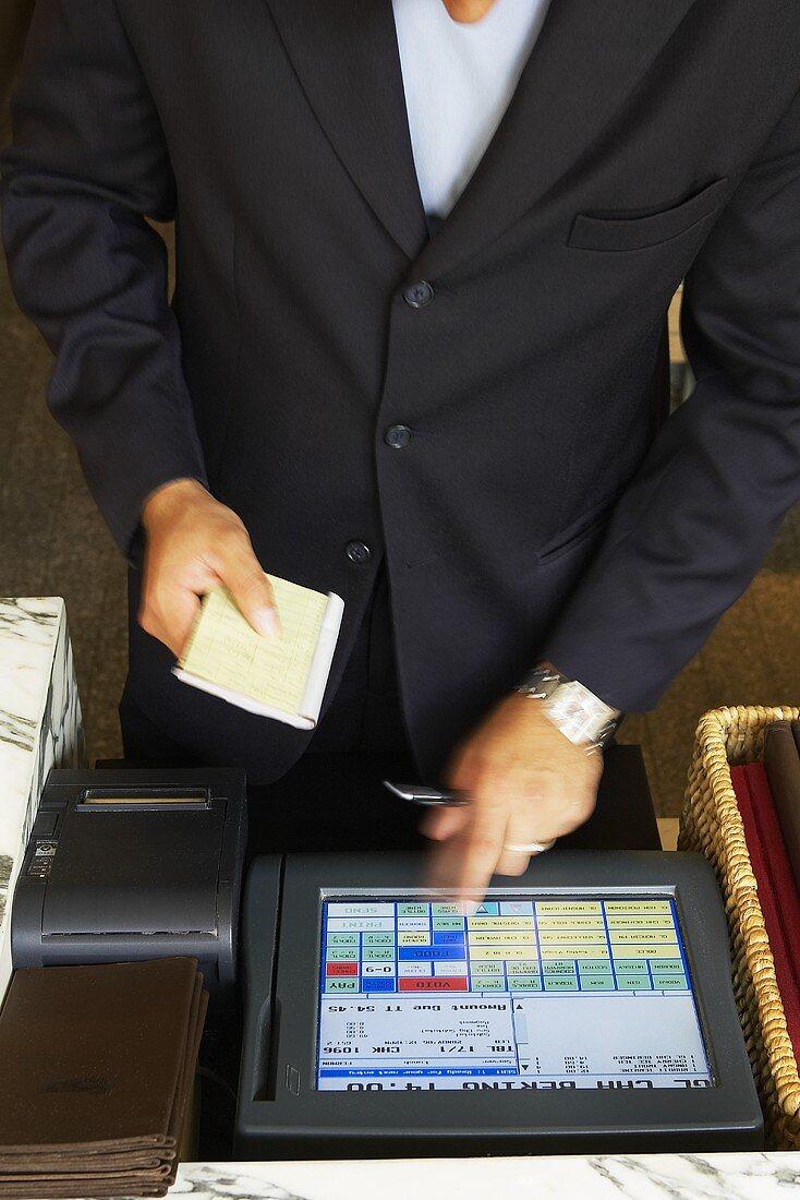 Waiter Calculating Bill at Register; Blue Duck Restaurant