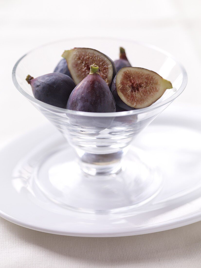 Whole and Halved Figs in a Glass Bowl