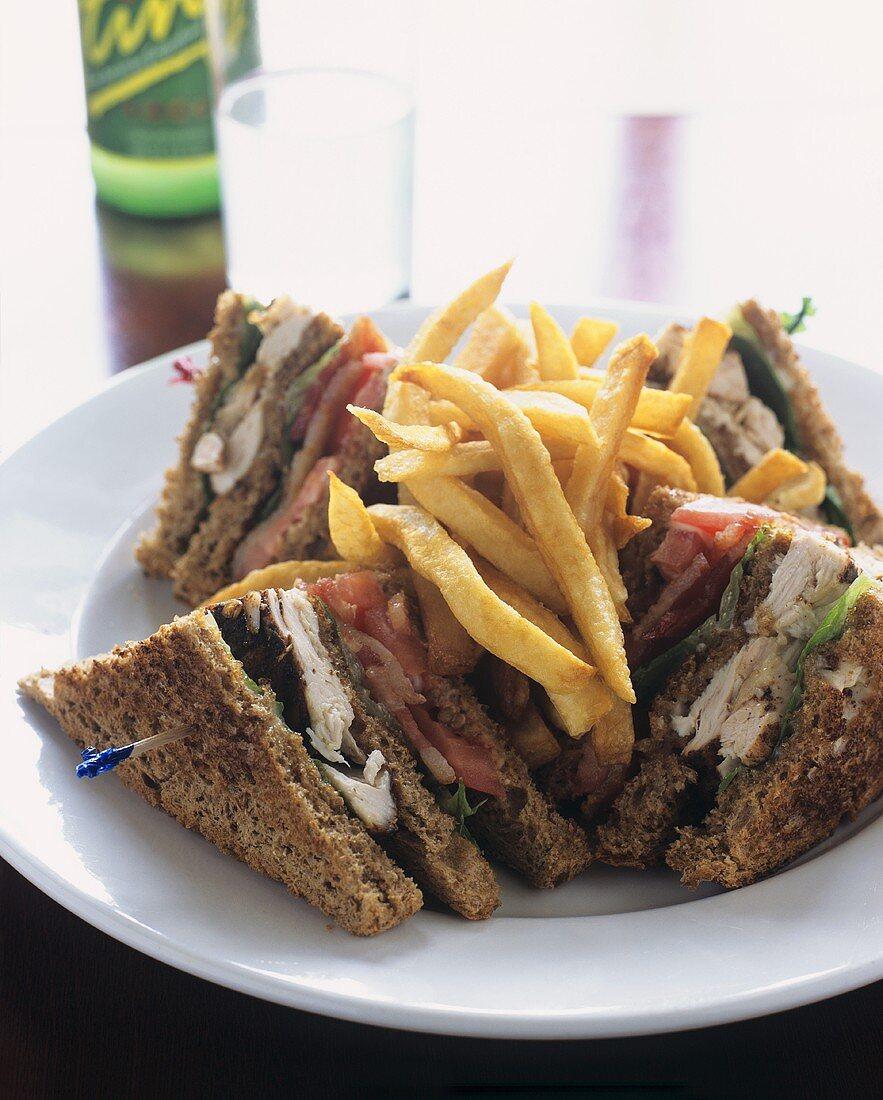 Jerk Chicken Club Sandwich with Fries