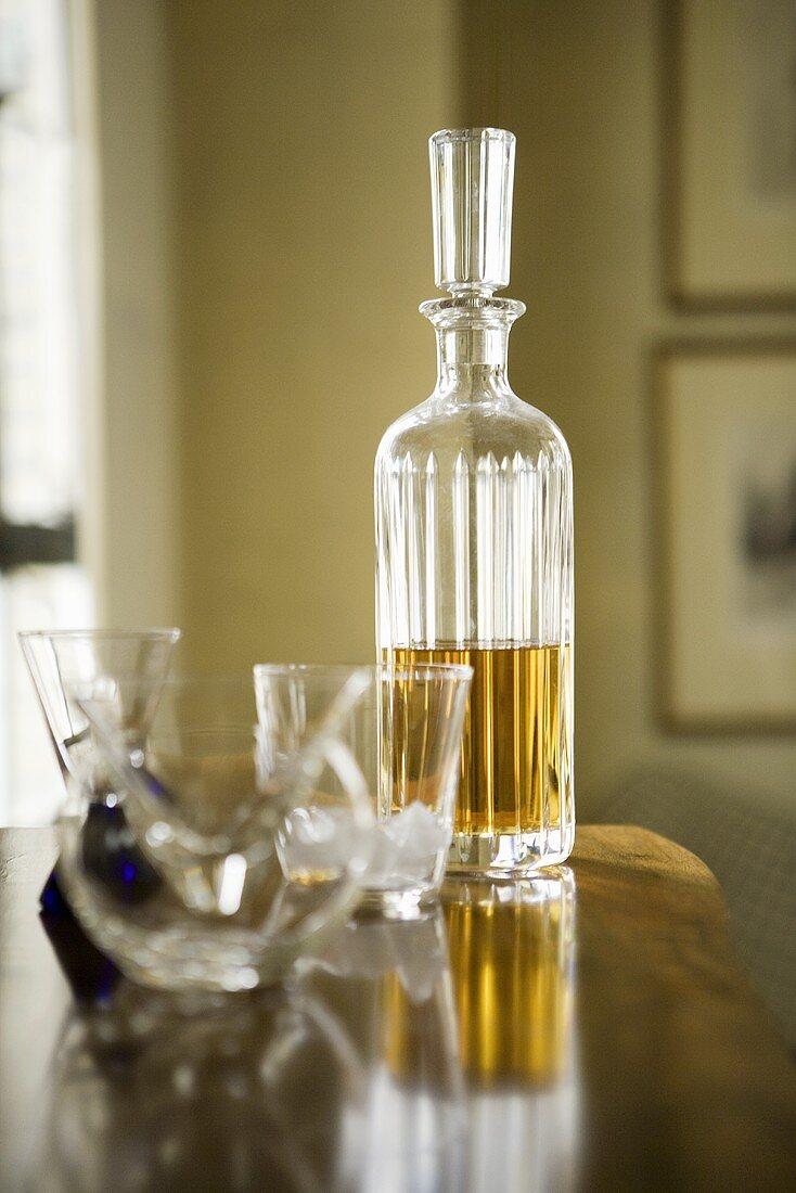 Various Cocktail Glasses; Bottle of Liquor