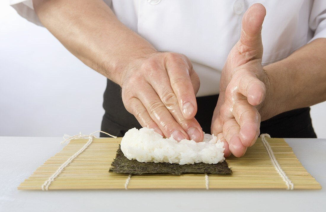 Chef Making a Sushi Roll