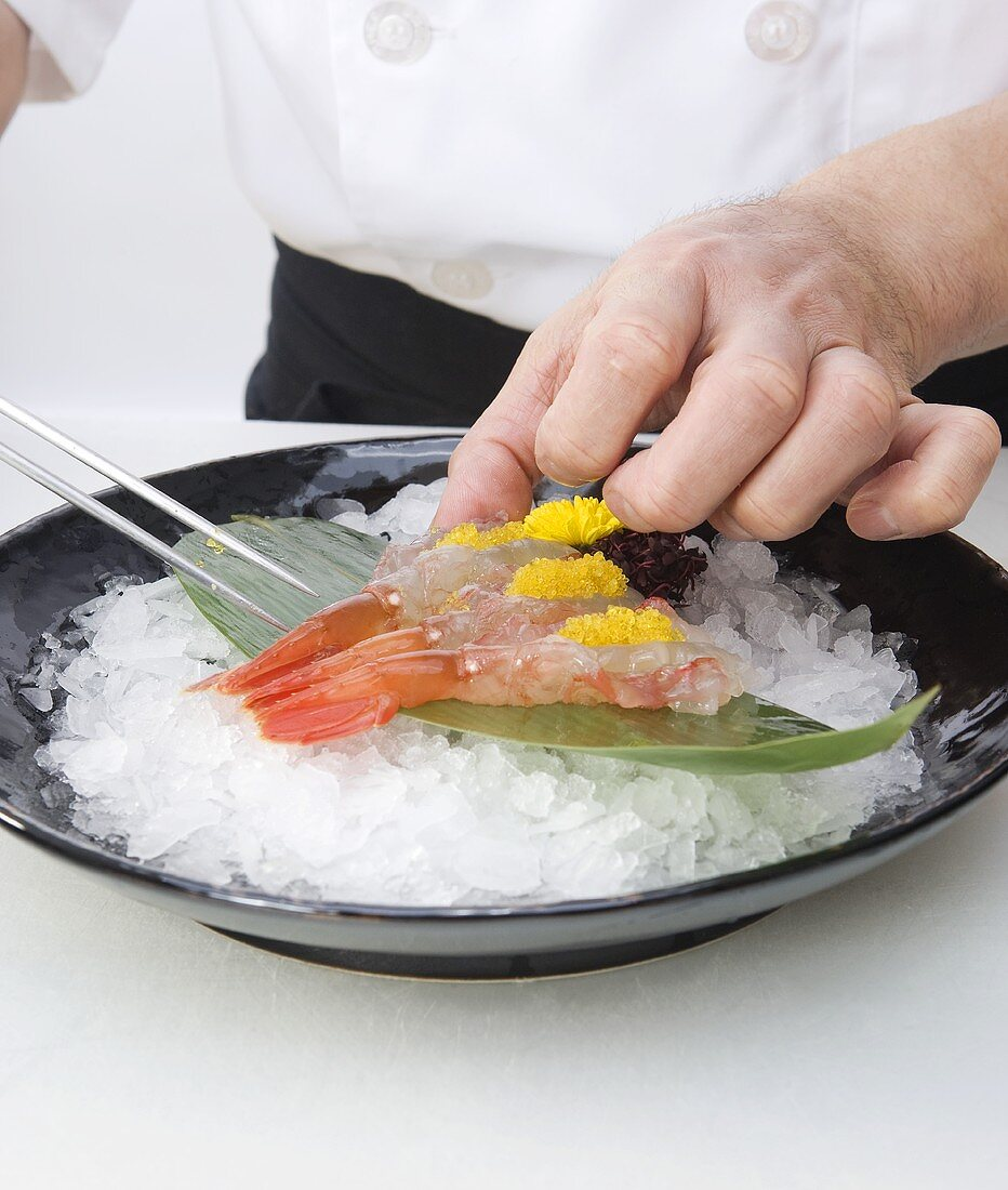 Sushi Chef Serving Santa Barbara Spot Prawn Over Ice on Leaf with Roe