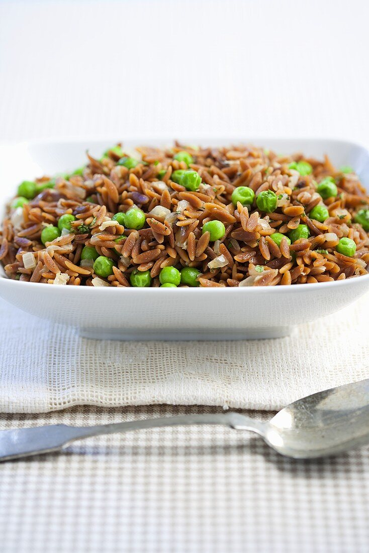 Toasted Orzo Pilaf with Peas in Serving Bowl