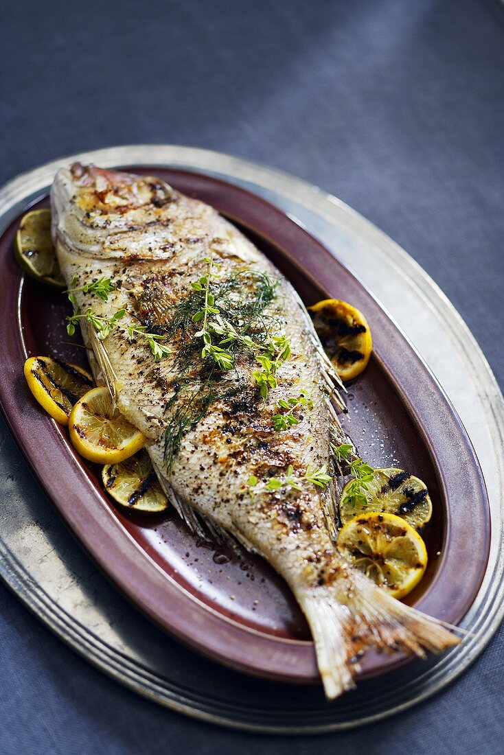 Whole Cooked Fish with Lemon on Platter