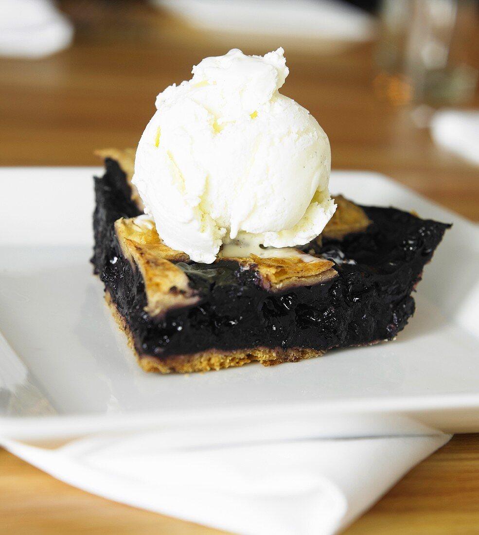 Piece of Blueberry Pie with Scoop of Vanilla Ice Cream