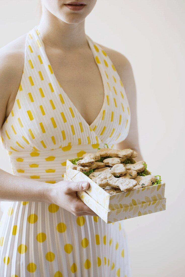 Woman Holding a Box of Homemade Dog Cookies