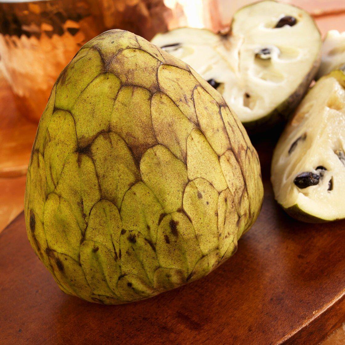 Whole Cherimoya Fruit with Sliced Cherimoya Fruit