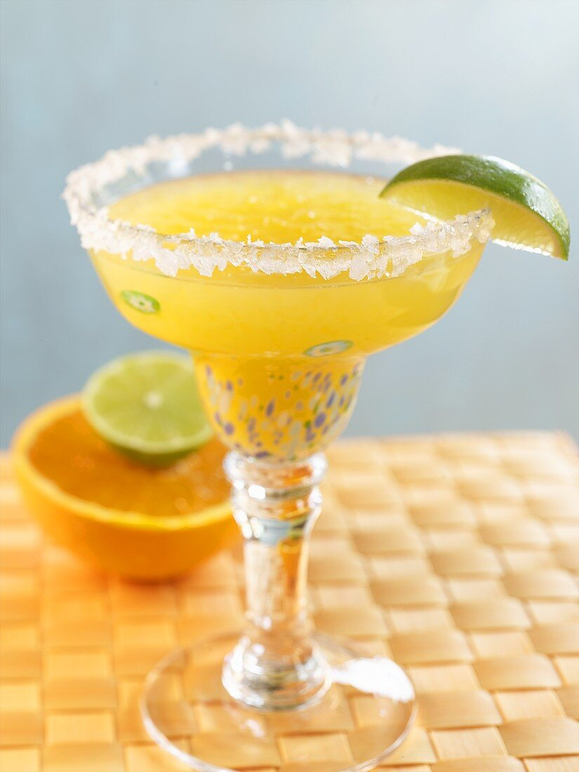 Orange Lime Margarita in Glass with Salted Rim