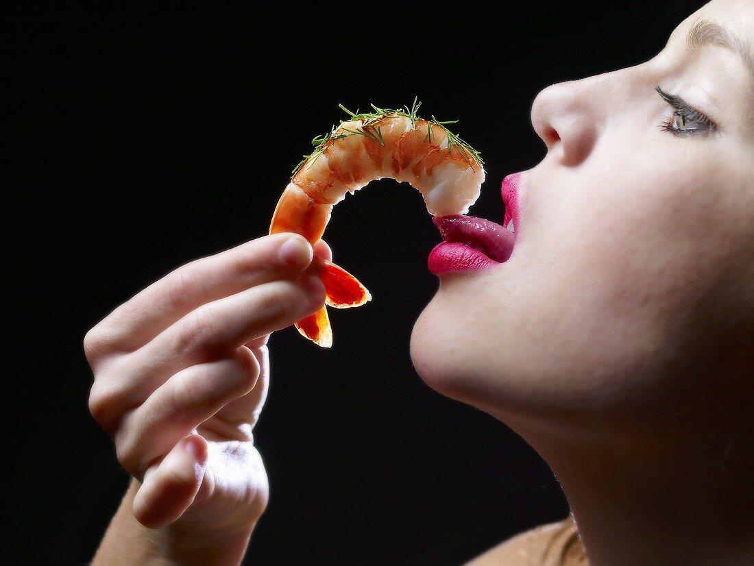 Woman Eating a Shrimp