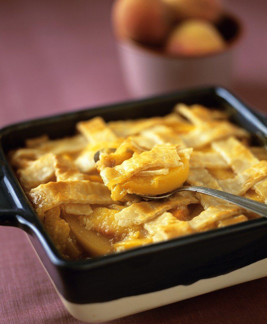 Double Crust Peach Cobbler; Spoon