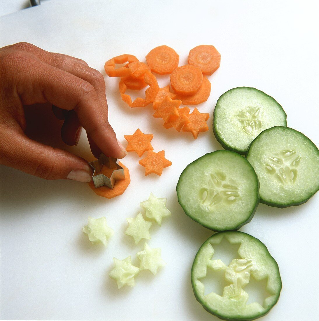 Cutting out carrot and cucumber stars