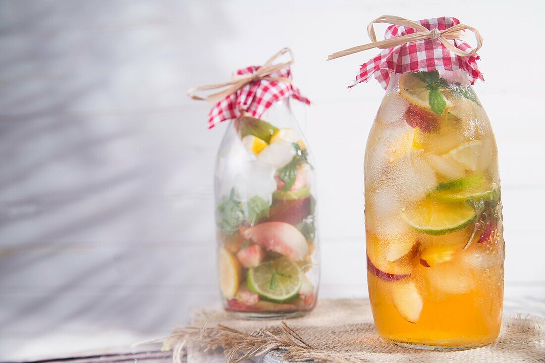 bottle of infused fruit tea with peach and lemon.