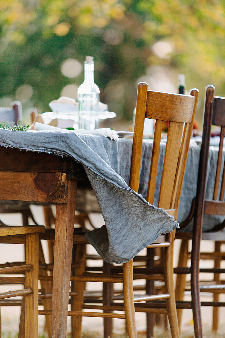 Tablecloth on empty table blowing in wind