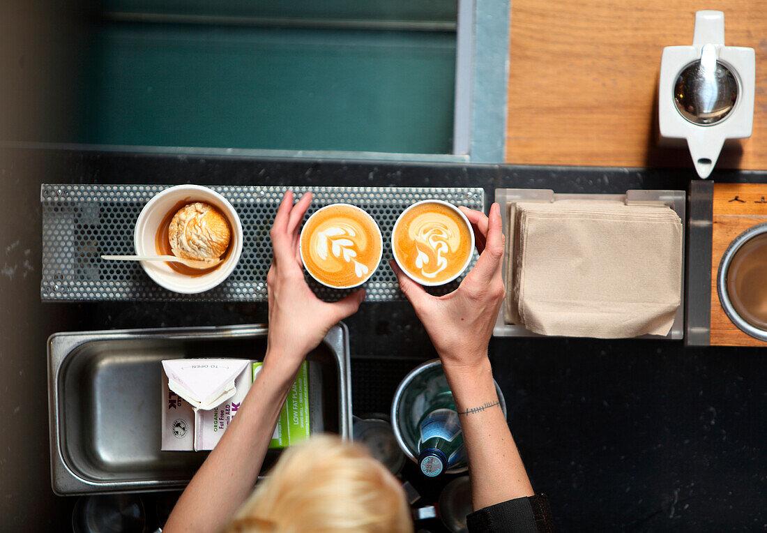 Preparing coffee with milk pattern, Oakland, USA