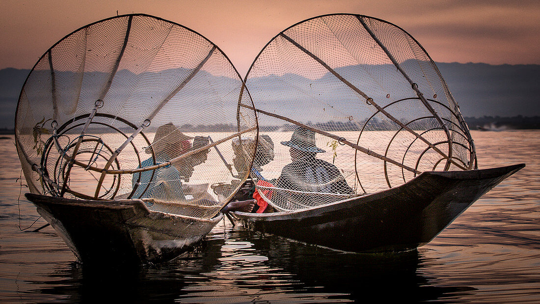 The fishermen using their own technology and conical nets on Inle Lake in Myanmar