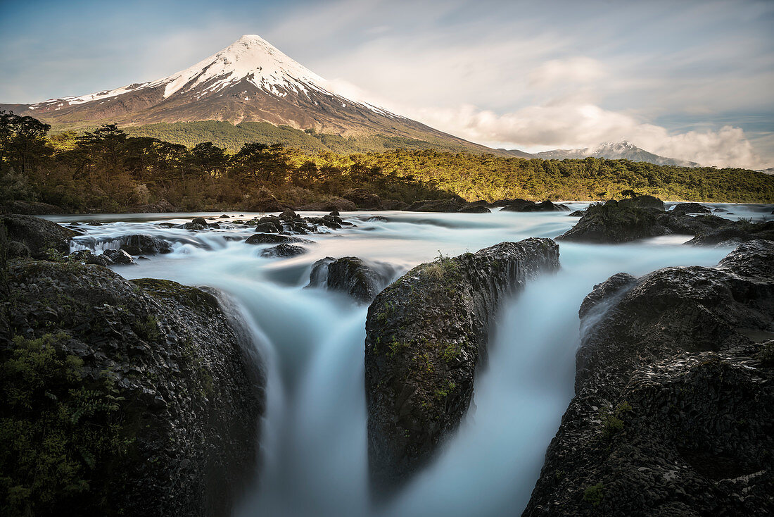 View over somersault (waterfalls) of the Rio Petrohue to the Osorno volcano, Region de los Lagos, Chile, South America