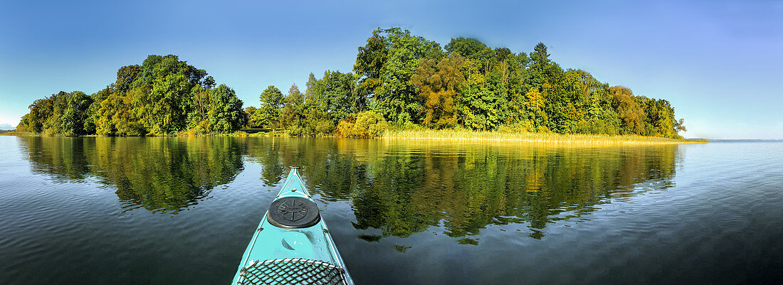View from a kayak on Lake Starnberg with trees in the background, Bavaria, Germany