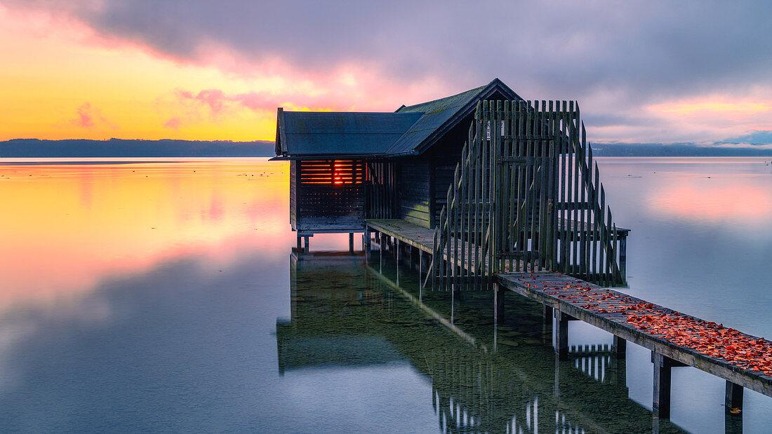 Boat hut at sunrise on Lake Starnberg, Tutzing, Bavaria, Germany