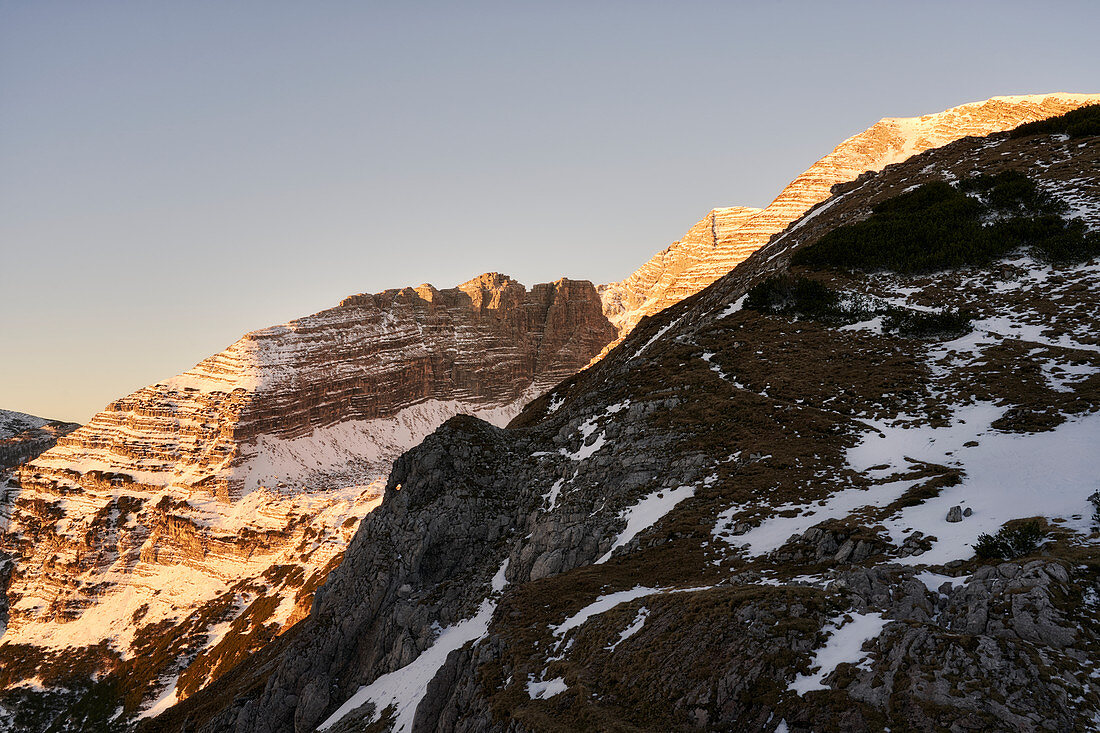 Sunrise in the Limestone Alps, Upper Austria, Austria. The rock bands of Ramesch and Warscheneck are illuminated by the morning sun