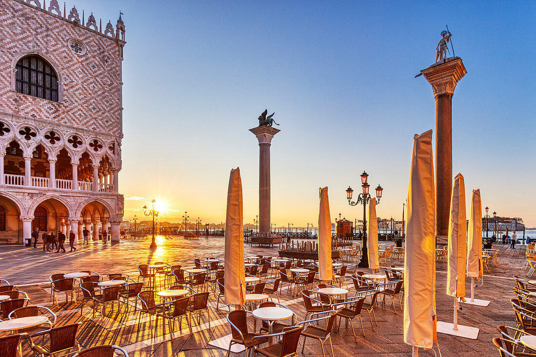Palazzo Ducale (left) and Piazzetta S. Marco at sunrise in Venice, Veneto, Italy