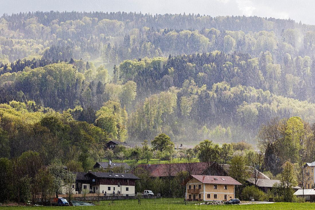 Rain in the sun next to Bad Feilnbach, Bavaria, Germany