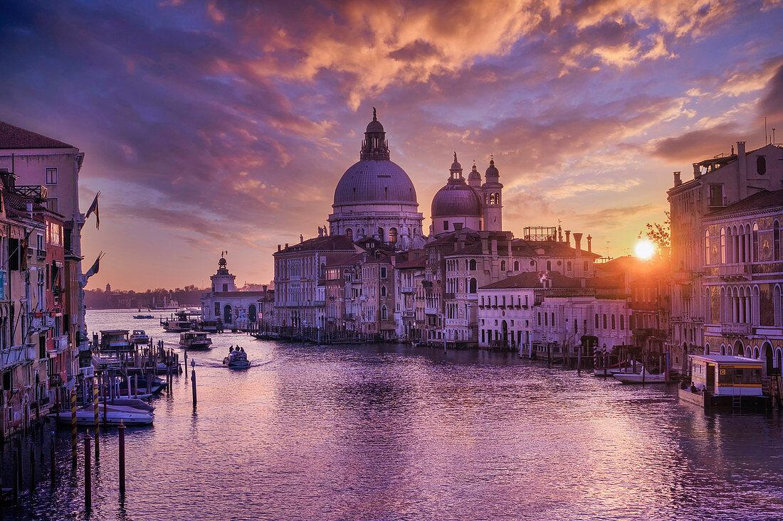 Grand Canal in the early morning light with Palazzo Cavalli-Franchetti and Santa Maria della Salute, Venice, UNESCO World Heritage Site, Venice, Veneto, Italy