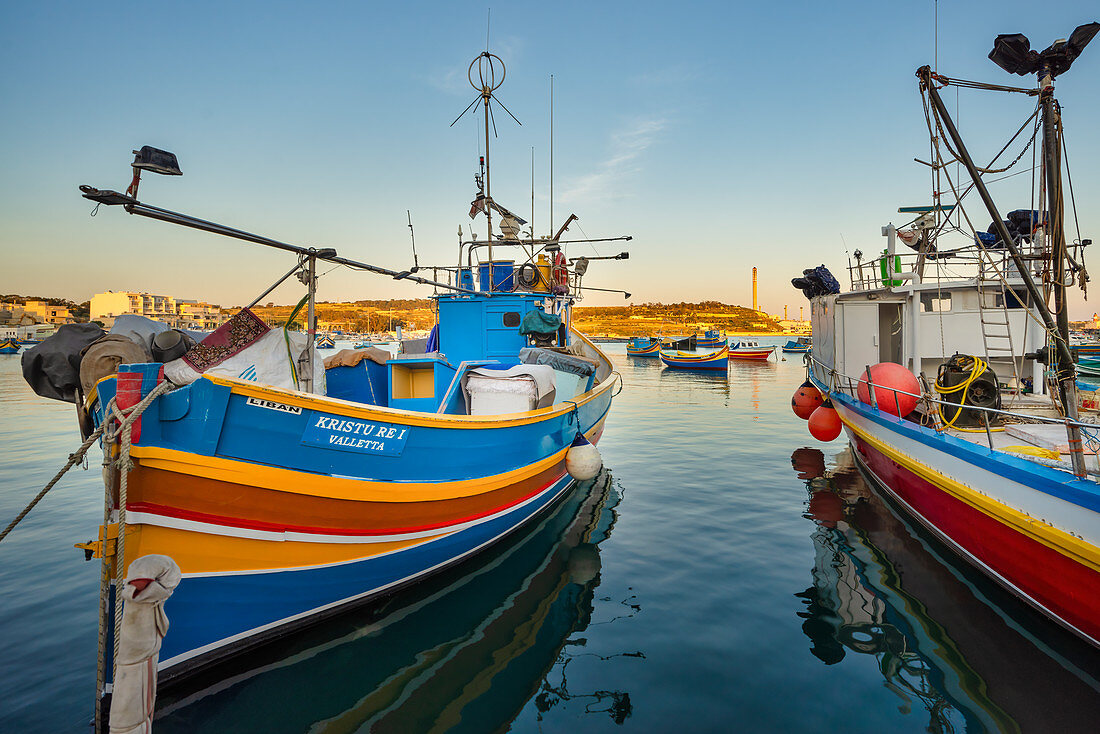 Colorful fishing boats lie in the harbor at Marsaxlokk, Malta, Europe