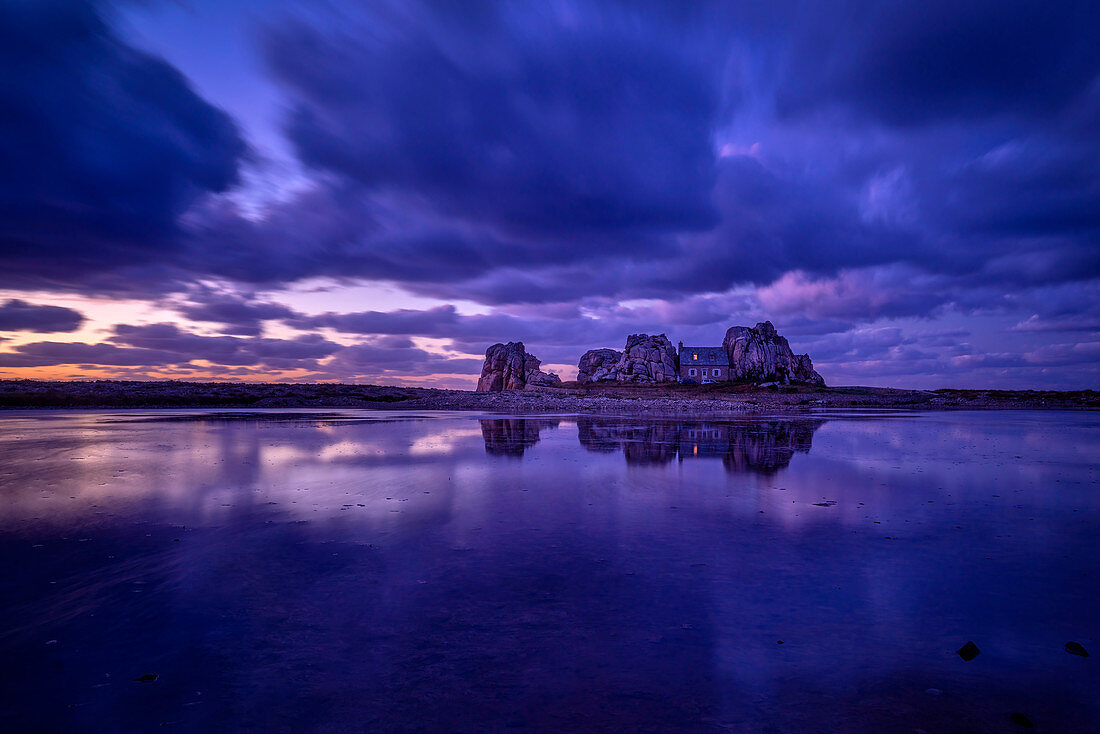 The house between the rocks after sunset, Le Gouffre, Plougrescant, Atlantic, Dept. Cotes-d'Armor, Brittany, France, Europe