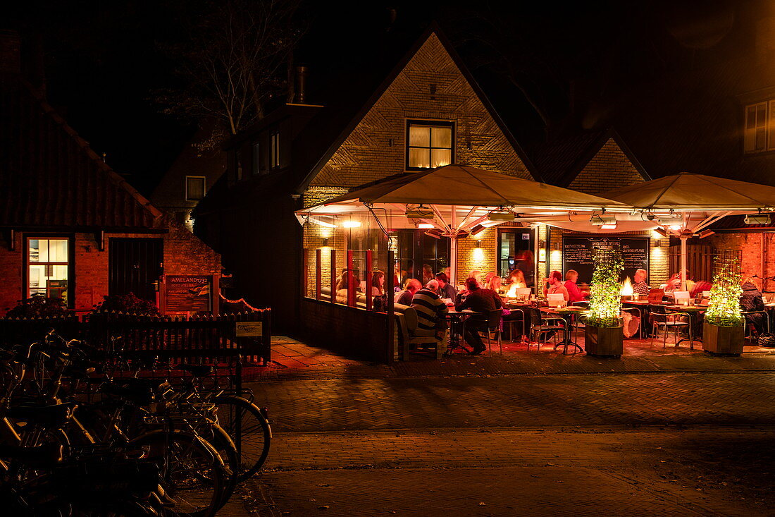 People sitting outside and enjoying dinner in the Rixt restaurant at night, Nes, Ameland, West Frisian Islands, Friesland, Netherlands, Europe