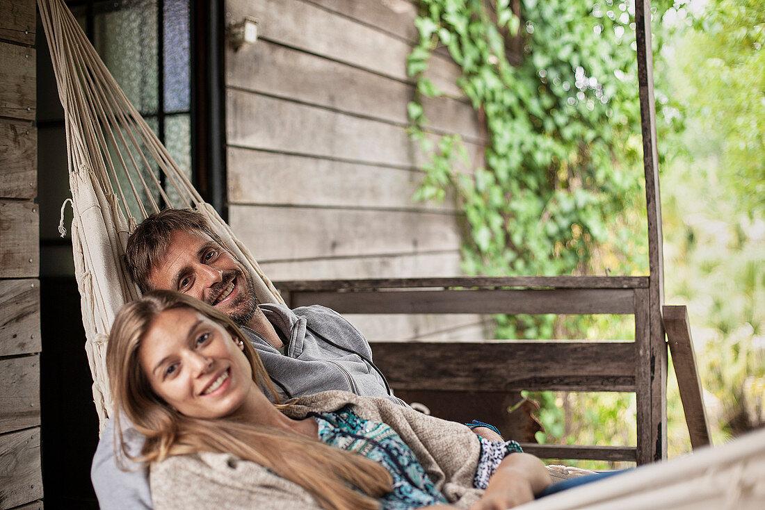 Portrait of couple relaxing in hammock