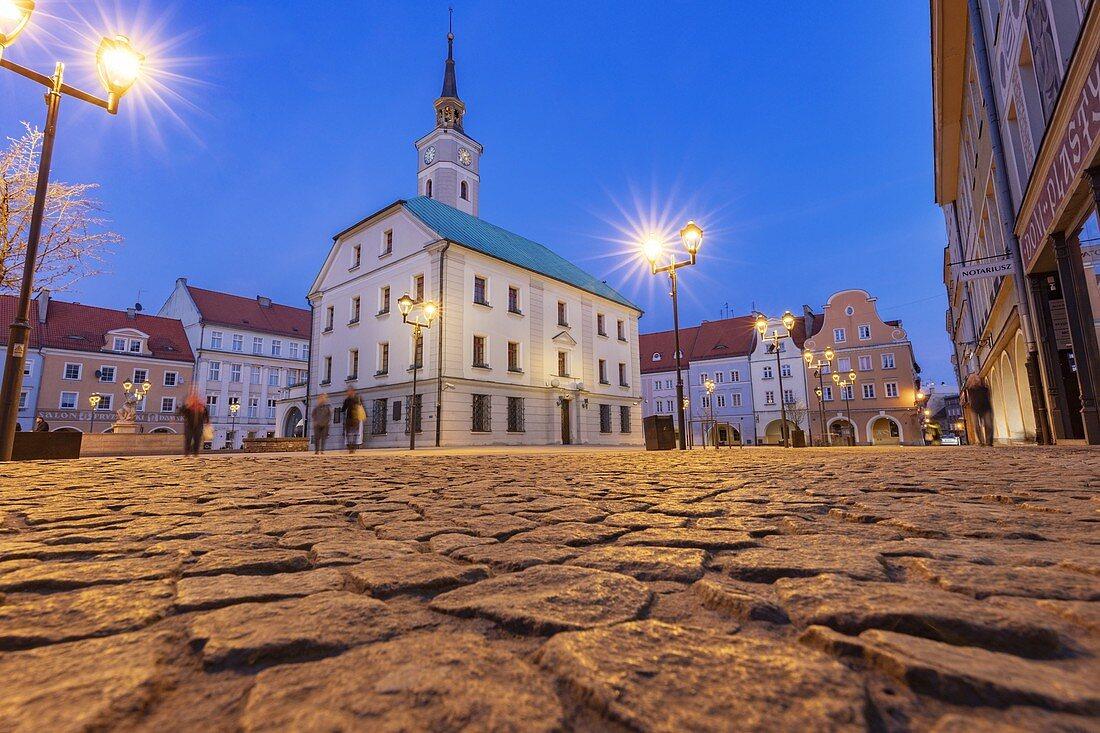 Poland,Silesia,Gliwice,Illuminated town square with cobblestone