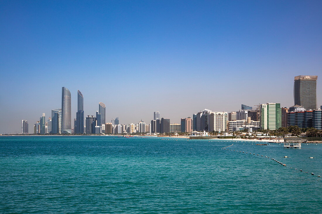 City skyline seen from the beach at Heritage Village, Abu Dhabi, Abu Dhabi, United Arab Emirates, Middle East