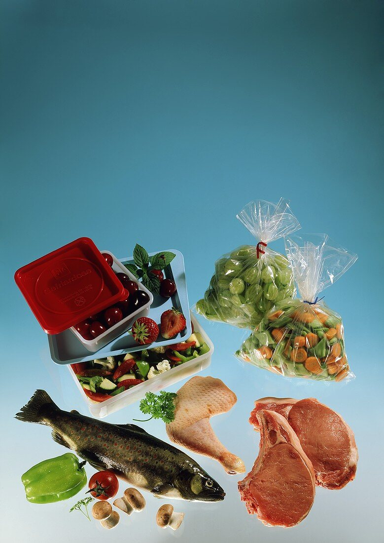 Frozen food still life with fish, meat, vegetables and fruit